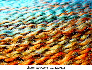 Skein of wool yarn. Macro shooting. Texture of wavy thread. Bright multicolor threads. Background image. Hobbies leisure crafts