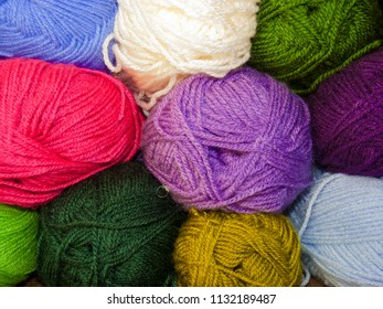 Skeins of colored wool, wall of multicolored skeins of wool