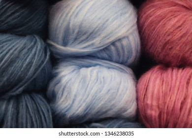 Skeins of colored yarn. Background of balls of yarn.