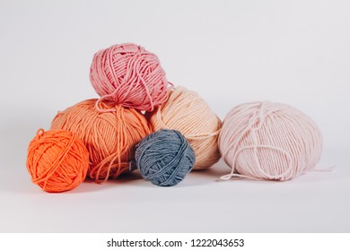 Skeins of colored yarn, on a white background