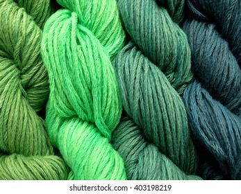 Skeins of Yarn in greens and blues, close up, background, texture, yarn, fiber, knitting
