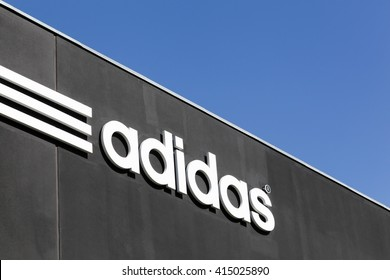 Skejby, Denmark - May 1, 2016: Adidas logo on a wall. Adidas is a German multinational that manufactures sports shoes, clothing. It is the second biggest sportswear manufacturer in the world