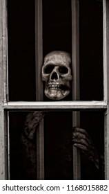 Skeleton behind bars