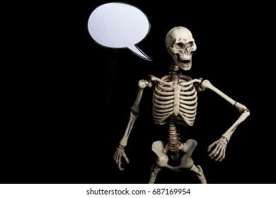 Skeleton with black background and speech bubble