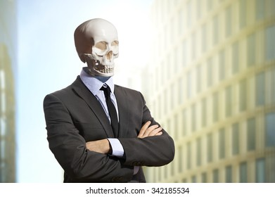 Skeleton in business suit standing with arms crossed