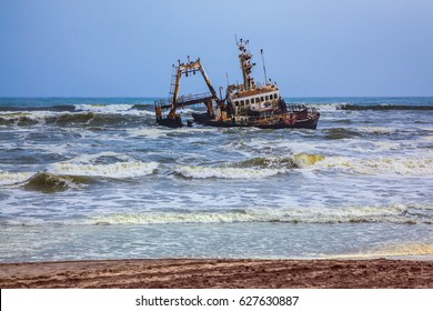 """Skeleton Coast"" in Namibia. The ship is stranded or grounded many years ago. Rough surf of the Atlantic"