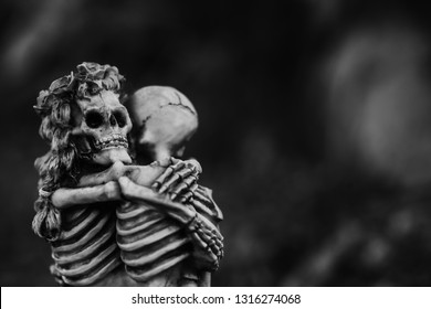 Skeleton couple in love and hug.Love never died concept.Still life image of human skeleton hug and love till death us do part.