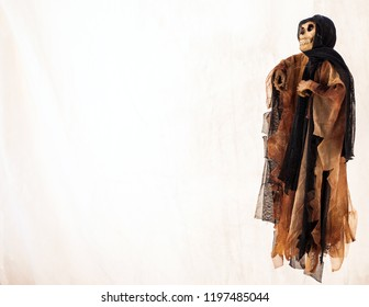 Skeleton depicting death on a white background.