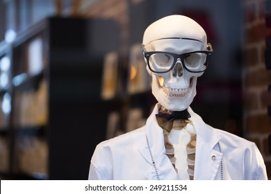 Skeleton dressed as doctor with glasses and bowtie