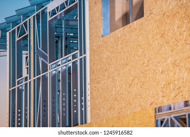 Skeleton Frame Residential Construction. Closeup Photo. Metal Frame and the Plywood Walls.