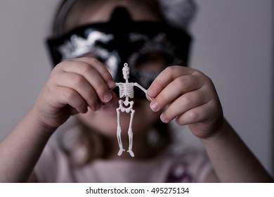 A skeleton, a girl, and a candle.