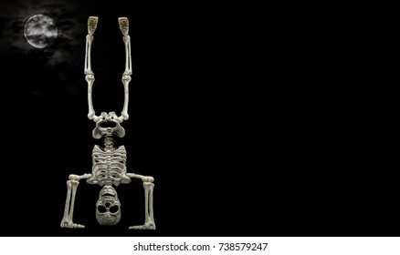 Skeleton Hand Stand / Scene showing a Halloween skeleton doing a hand stand with a nice cloud covered moon in the background
