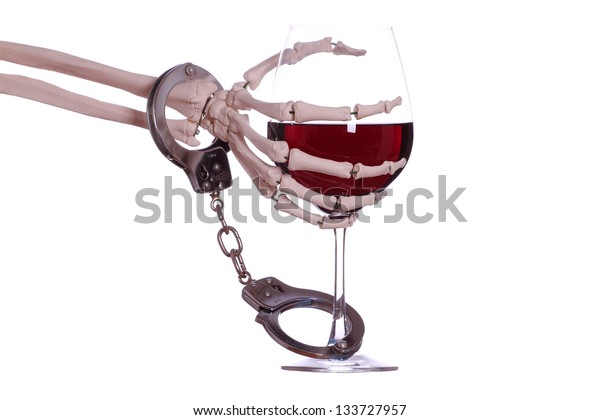 skeleton hand with wine and handcuff