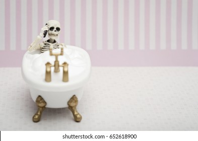 Skeleton having a phone call while having a bubble bath