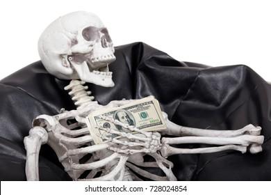 Skeleton holds money.