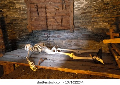 skeleton lying on the table in a antic torture chamber in Martigny, Switzerland