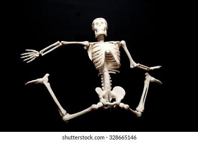 Skeleton model action on black background.