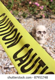 Skeleton on the ground surrounded by caution tape.