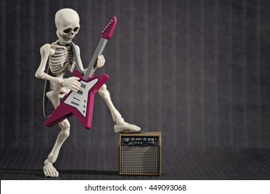 A Skeleton playing his electric guitar