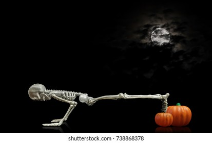 Skeleton Push ups / Halloween skeleton doing push ups on a pumpkin under a nice nighttime moon covered with dark clouds.