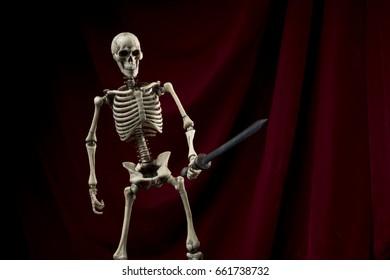 Skeleton with red velvet background and sword
