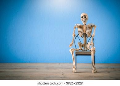 Skeleton sit on chair ,Still life ,waiting symbol