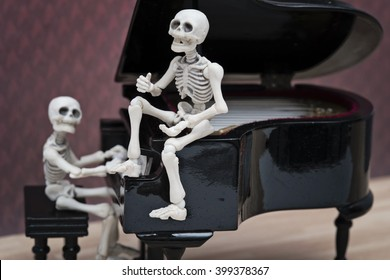 A skeleton sitting on piano and singing and a skeleton pianist