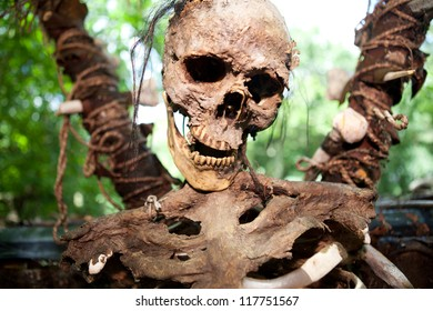 skeleton skull on stake, human sacrifice in jungle. creepy dead person