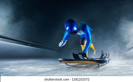 Skeleton sport. The athlete descends on a sleigh on an ice track. Winter sports