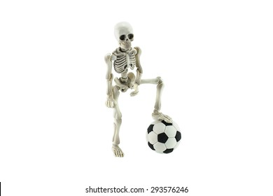 Skeleton standing and soccer ball isolated on white background football never die concept