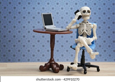 Skeleton talking on the phone