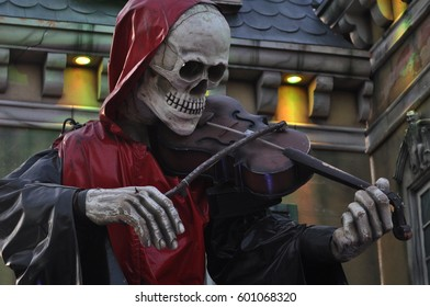Skeleton Violinist on ghost ride AT fun fair