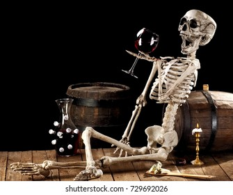Skeleton with a wine glass in winery