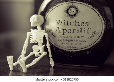 skeleton with witches brew for halloween