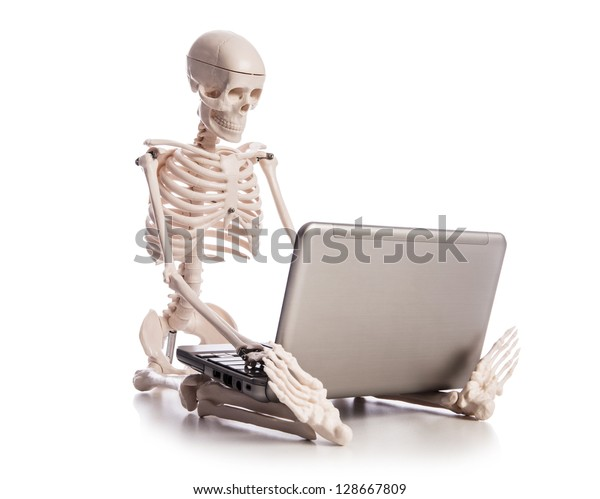 Skeleton working on laptop