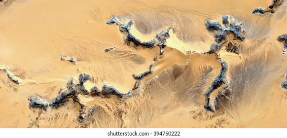 skeletons stone, Fossil remains of the couple's first human to try to cross the Sahara, abstract photography of the deserts of Africa from the air, bird's eye view, abstract expressionism,
