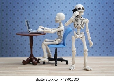 Skeletons working in the office