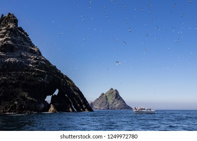 Skellig Islands in Atlantic Ocean on the West Coast of Ireland with small boat and gannets.