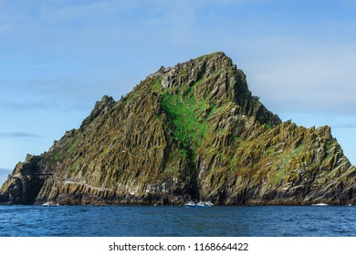 Skellig Michael in the Atlantic ocean next ot the shore of ireland, europe under a beautiful blue sky