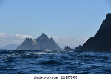 Skellig Michael island - little Skellig in blue ocean cliffs in Ireland