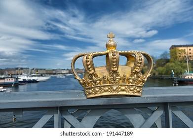 Skeppsholmsbron (Skeppsholm Bridge) with its famous gilded crown and Strandvagen in background.