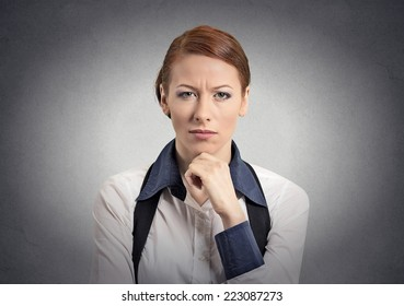 Skeptic doubtful woman looking at you camera isolated grey wall background. Negative human emotion facial expression feeling body language attitude