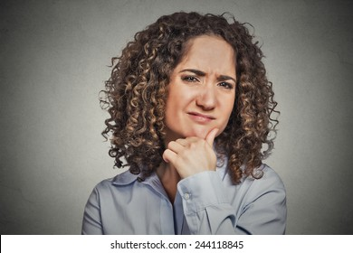 Skeptic. Doubtful woman looking at you camera isolated grey wall background. Negative human emotion facial expression feeling body language attitude