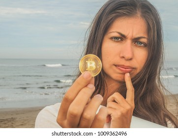skeptical Woman with BitCoin on the beach