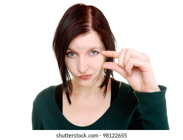 skeptical woman describes a size with her fingers