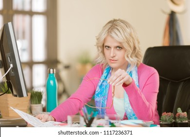 Skeptical young woman working at her desk