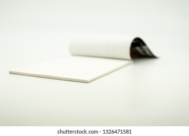 Sketch pad lying open on a white background