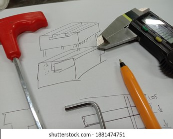 Sketch of random part. Micrometer screw gauge and  allen key on white paper. Sketch is rough idea before actual product is exist.