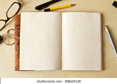 Sketchbook note pad with empty paper page and pencil