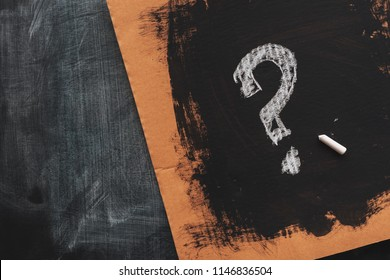 Sketched question mark on cardboard paper, concept of perplex and confusion